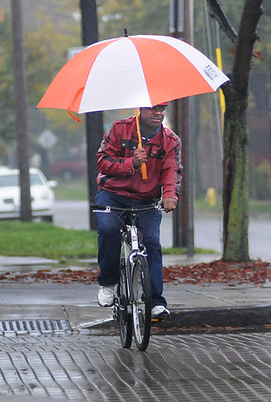 James Neiss/staff photographerNiagara Falls, NY - A little rain didn't keep Danny Stewart of 18th street from running his daily errands. Stewart was seen riding his bicycle high and dry in the 1800 block of Pine Avenue.