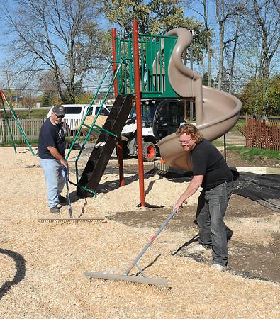 James Neiss/staff photographerNiagara Falls, NY - Niagara Falls Parks workers Brian Raymond and Joe Olscamp spread wood chips around the new play area at Griffon Park.