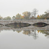 James Neiss/staff photographerNiagara Falls, NY - The Hyde Park Lake Bridge and surrounding trees are reflected in the calm waters on a cool fall day.