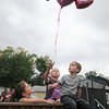 James Neiss/staff photographerNiagara Falls, NY - Loretta Gates children Mariah Martin, 5, Kyla Lewis, 11 and Peter Martin, 4, launch a balloon with personalized drawings and messages for their mother.