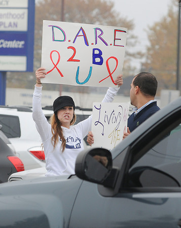 """James Neiss/staff photographerNiagara Falls, NY - Erika Cooper of Niagara Falls protests against illegal drug use on the corner of Pine Avenue and Portage Road. The Northpointe Council hosted """"Take A Stand Day"""" on Wednesday, as part of Red Ribbon Week, touted as being one of the oldest and largest drug prevention programs in the nation."""
