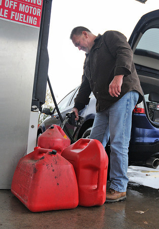 James Neiss/staff photographerSanborn, NY - Ray Birch of North Tonawanda fills up three 5 gallon gas cans at Jay's Place on Walmore Road, for his generator, he said.