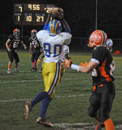James Neiss/staff photographerWilson, NY - Wilson Lakemen look on as Cleveland Hill #80 intercepts the ball during playoff game action in the 2nd Quarter.