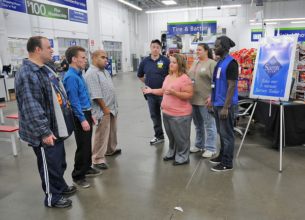 James Neiss/staff photographerNiagara Falls, NY -  Sam's Club Marketing Manager Amy Benjamin greets visitors from Opportunities Unlimited of Niagara who are going to shadow employees as part of Disability Mentoring days in celebration of National Disability Employment Awareness Month. Participating from left are, Brian McDonald, Bert Jermy, Manny Gutierrez, Grocery Supervisor Kieran Stitt, Amy Benjamin, Cafe Supervisor Lynde Hewitt and Produce Associate Jamie Howard.