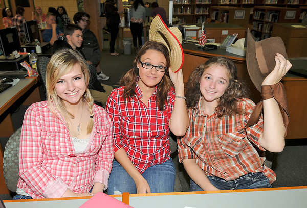 James Neiss/staff photographerLewiston, NY - Seniors Geri Lynn Berard, Alexis Azzarelli and Lizzie Raby were happy to oblige a visitor with happy smiles and tips of the hat on Wester Day at Lewiston-Porter High School on Wednesday.