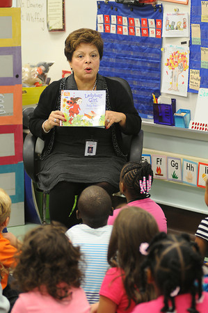 """James Neiss/staff photographerNiagara Falls, NY - Niagara Falls School Superintendent Cynthia Bianco reads the book """"Ladybug Girl and the Bug Squad"""" to kindergarten students in Mrs. Marre Campell's class at the Maple Avenue Elementary School. Dignitaries from around the community stopped into area schools to read the book as part of the national campaign """"Read for the Record."""""""