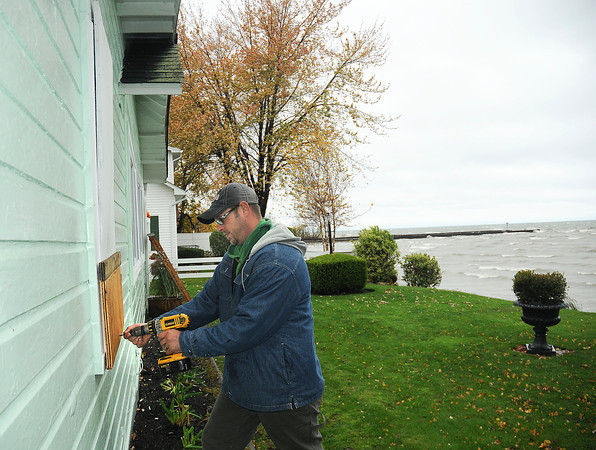 James Neiss/staff photographerWilson, NY - Jeffrey Marsh boards up windows at his Lake Ontario waterfront home on Ontario Street in preparation for a big storm. Marsh, said he and his family plan to weather the storm though advised by Wilson Village Deputy Mayor Bernie Leiker to evacuate, because of the potential for 25 foot waves.