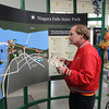 James Neiss/staff photographerNiagara Falls, NY - Tourist Mike Hahn from Columbus, Indiana, get's his bearings at the Orin Lehman Visitors Center before heading out to see the sights at Niagara Falls State Park. State officials, said attendance was up this year.
