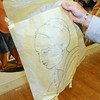 James Neiss/staff photographerBuffalo, NY - Artist Roman Kujawa uses tracing paper to aid in painting on oversize canvases. Kujawa has been commissioned to create religious paintings for St. Joseph's Church in Niagara Falls.