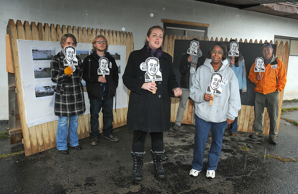 """James Neiss/staff photographerNiagara Falls, NY - Meghan Miller, chair of the Niagara Organizing Alliance for Hope, Art as Action Task Force, front left, Joined by NOHA member Yvonne Taylor, right, announces the Art as Action Taskforce. The taskforce is aimed at bringing attention to the lack of responsible economic redevelopment in the East Falls district of the city. The campaign, """"Who Is Milstein?"""" is taking aim at Niagara Falls Redevelopment and its sole owner and land speculator Howard Milstein, by featuring a new website  <a href=""""http://www.whoismilstein.com"""">http://www.whoismilstein.com</a>."""