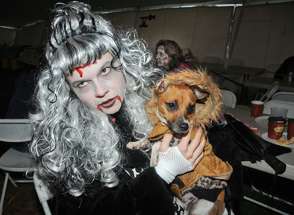 James Neiss/staff photographerSanborn, NY - Sophie the dog seems a little uncomfortable with the affections of Zombie Dana Stefanko of Lockport at the first annual Niagara SPCA Zombie Fest.