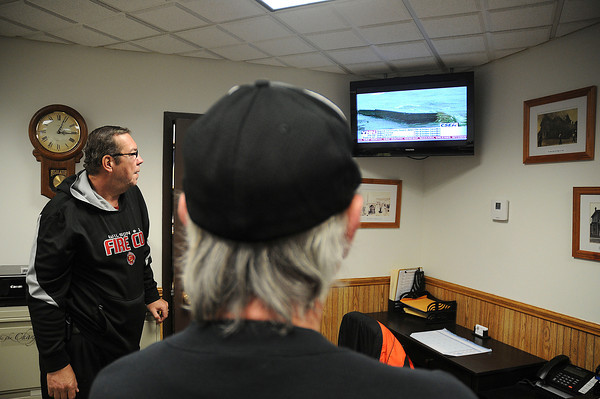 James Neiss/staff photographerWilson, NY -  Wilson Fire Department Accountability Officer George Schoelles, left and Robert  Linddell, assistant fire chief, watch news about the local weather as members of the fire department prepare for the developing storm.