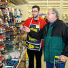 James Neiss/staff photographerNiagara Falls, NY - Value home store Sales Associate Justin Simpson helps Frank Zuhlke of Lewiston, make a battery selection. In addition to batteries, Zuhlke, said he was picking up essentials including a flashlight.