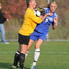 James Neiss/staff photographerWilson, NY - Wilson girls soccer goalie Grace Adams protects the ball from Newfane #5 Samantha Brick during game action in Wilson.