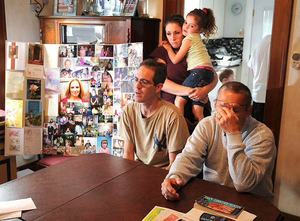 James Neiss/staff photographerNiagara Falls, NY - Father of two of Loretta Gates Children Scott Martin, family friend Lisa Nicoloff, daughter Mariah Martin, 5, and Loretta's father Arthur Gates gathered to talk about their loved one who was murdered.