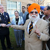 James Neiss/staff photographerNiagara Falls, NY - Police Superintendent John Chella, left, is all smiles after receiving a check for $3500 from the Niagara Sikh Association for a wounded Oak Creek, Wisconsin, police officer who came to the rescue of other members of the community during a temple shooting there. Niagara Sikh board president Dr. Surjit Singh, right, said over $1 million has been raised so far for the officer.