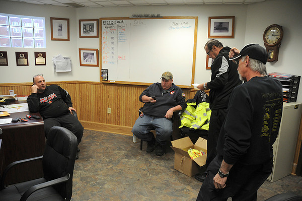 James Neiss/staff photographerWilson, NY - CALM BEFORE THE STORM:  Wilson Fire Chief Russell Jackman II, left, Robert Siegmann, marine captain, George Schoelles, accountability officer and Robert  Linddell, assistant fire chief, discuss preparations for the storm including setting up as an evacuation shelter for those who need it.