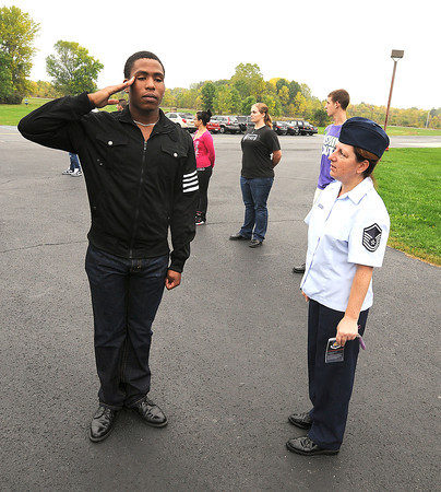 James Neiss/staff photographerLewiston, NY - MSGT. Theresa Demers evaluates Alexander Matthews, of Niagara Falls High School, as he present arms during a lesson on drilling at Lewiston-Porter High School. The students are part of the BOCES Aerospace Education program, said Demers.