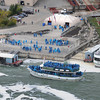 James Neiss/staff photographerNiagara Falls, NY - Passengers wait for the next boat as the Maid of the Mist leaves the dock on the Canadian side of the Niagara River.