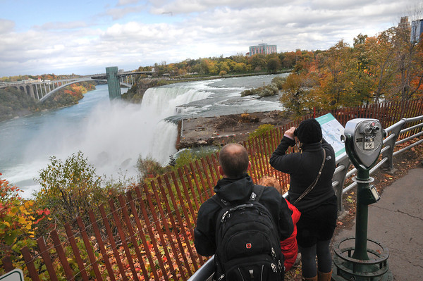 James Neiss/staff photographerNiagara Falls, NY - Tourists view the American Falls from Goat Island. State officials, said attendance was up this year.