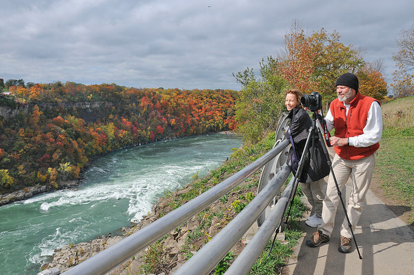 James Neiss/staff photographerNiagara Falls, NY - Ed Stilwell and his wife Candace Knab enjoy the peak fall colors at Whirlpool State Park. Knab, a former resident of Niagara Falls, brought her husband here to visit with family and see the sights.