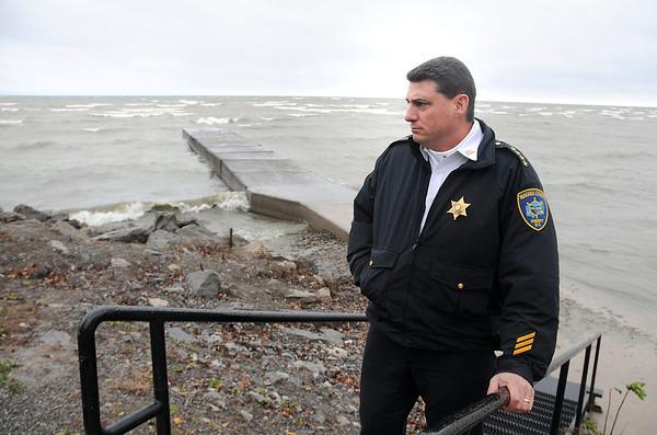 James Neiss/staff photographerWilson, NY - Niagara County Sheriff James Voutour surveys the Wilson shoreline on Lake Ontario at the foot of Lake Street on Monday.