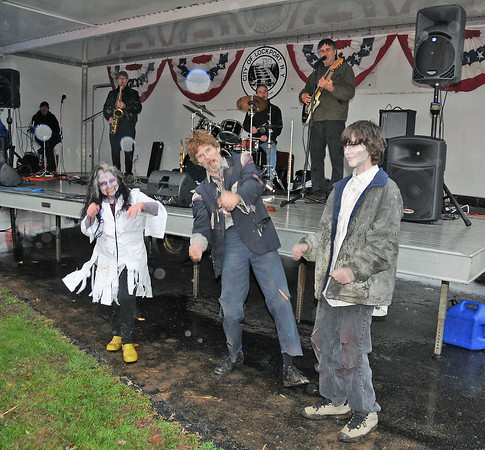 James Neiss/staff photographerSanborn, NY - Ghostly orbs of light dance along with Zombie's, Dr. Susan Persico, Bill Baldwin of Depew and his son Liam, 13, as they rock out to the sounds of the band Pocket Change at the first annual Niagara SPCA Zombie Fest.