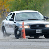James Neiss/staff photographerNiagara Falls, NY - Niagara County Sheriff Investigator Chuck Baker kicks up some dust as he gives Niagara County Law Enforcement Academy cadet Judith Dolan a hell ride during Emergency Vehicle Operator Course training in Niagara Falls. Dolan will become a Niagara Falls Police officer upon academy graduation.