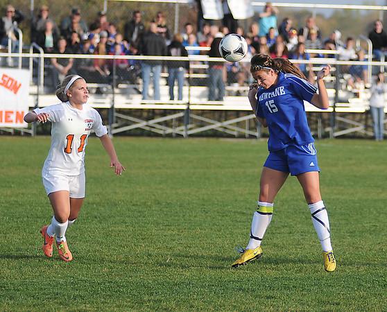 James Neiss/staff photographerWilson, NY - Newfane girls soccer player #15 Kayla Licht head butts the ball as Wilson defender #11 Angela Goodman looks on.