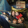 James Neiss/staff photographerNiagara Falls, NY - Courtney Quartararo, her son Gage, 3, daughter Jocelynn Kennedy, 6 and their cousin Juliette Roma, 10, look for warm winter coats at Capitol Cleaners on Main street as part of the first distribution of Coats For Kids. The second distribution will be from 10 a.m. to 2 p.m. on November 24.