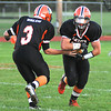James Neiss/staff photographerWilson,  NY - Wilson Lakeman #3 Timothy Walch hands off the ball to #21 Justin Slango during the first quarter of football game action against Fredonia.