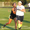James Neiss/staff photographerAmherst,  NY - Brunette team member Alison Barone of the Town of Tonawanda, left, tags a teammate during practice at Sweet Home High School. The Blondes V.S. Brunettes charity football game will be held there on Saturday. Proceeds are to benefit the Alzheimer's Association.