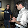 James Neiss/staff photographerNiagara Falls,  NY - Johnny Destino is displeased with polling numbers as he checks them on the internet with supporter Russ Thompson at the Giacomo.