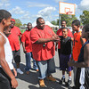 James Neiss/staff photographerNiagara Falls  NY - Coach Eric DAvis, director of the Cataract City Basketball leagues, talks to some of the players before a basketball game at Legends Court. Operation SNUG, a local non-violence group, sponsored a day-long basketball event at the park on Saturday.