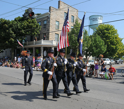 James Neiss/staff photographerYoungstown, NY - Members of local law enforcement including the Niagara County Sheriff's Honor Guard, followed by Sheriff James Voutour, lead off the annual Youngstown Labor Day Parade on Main Street.