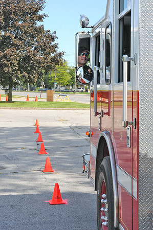 James Neiss/staff photographerNiagara Falls,  NY - Niagara Falls Firefighter Bart Derosa backs up Truck 3 between cones in an obstacle course at the old public safety building on Hyde Park Boulevard. Firefighters drive the course to gage their fire engine driving proficiency.