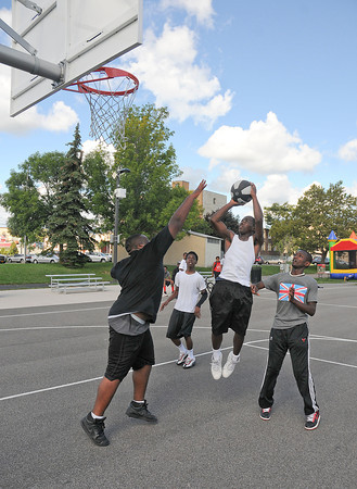 James Neiss/staff photographerNiagara Falls  NY - Te'Shawn McCreary shoots the ball during basketball game action at Legends Court. Operation SNUG, a local non-violence group, sponsored a day-long basketball event at the park on Saturday.