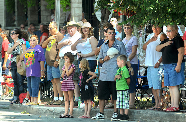 James Neiss/staff photographerYoungstown, NY - The crowd stands for the national anthem, kicking off the annual Youngstown Labor Day Parade on Main Street.