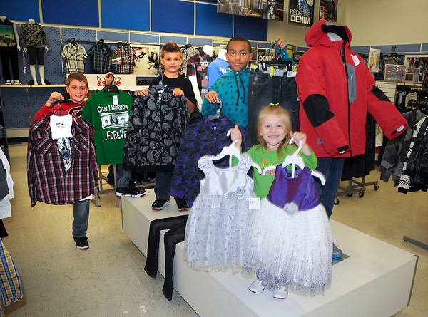 James Neiss/staff photographerNiagara Falls, NY - Harry F. Abate students show off some K-mart Fashions. From left are, Zachary Ripley, 9 in 4th grade, Francis Pecoraro, 8 in 2nd grade, Warren Vincent, 8 in 3rd grade and Marissa Pecoraro, 4 in Pre-k.