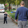 James Neiss/staff photographerNiagara Falls, NY - THE BOMB: Shawn Watson Jr. went long for a pass from his father Shawn in front of their 92nd Street home. The two were spending some quality time after school.