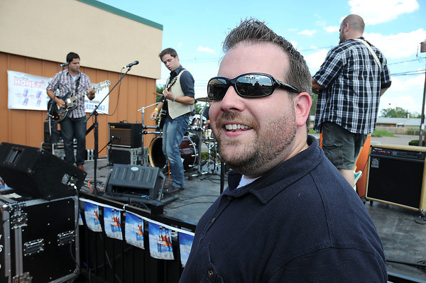 "James Neiss/staff photographerNiagara Falls, NY - Chris Mattice, tha namesake for Chrisfest 8, is all smiles as ""The Increase"" play for the crowd at Honey's on Niagara Falls Boulevard. The annual party put on by Mattice is helping to raise money for the family of murder victim Isabella Tennant."