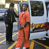 James Neiss/staff photographerLockport, NY - Convicted murderer Gordon Jackson goes to County Court for his sentencing.