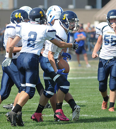 James Neiss/staff photographerNiagara Fa, NY - Kenmore East #5 Preston Smith celebrates after intercepting a pass in the first quarter of football game action against Grand Island.