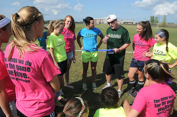 James Neiss/staff photographerNiagara Falls,  NY - Niagara Falls girls soccer coach William Schmidtke talks to his team during practice.