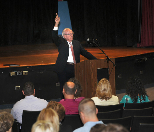 James Neiss/staff photographerSanborn,  NY - Niagara Wheatfield Interim Superintendent of Schools James Knowles uses the classic teachers one finger up to quiet the room before addressing district faculty in the auditorium at Niagara Wheatfield High School. School opens for the district and other area schools on Wednesday.