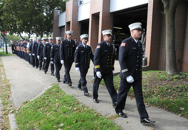James Neiss/staff photographerNiagara Falls,  NY - Niagara Falls Firefighters attend a service honoring the victims of the World Trade Center disaster on Sept, 11, 2001, the ceremonial placement of the first brick in a new memorial patio and the dedication of the fire Engine #2 at the Royal Avenue Firehouse on Tuesday morning.