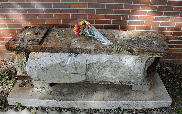 James Neiss/staff photographerNiagara Falls,  NY - An anonymous person place flowers on the World Trade Center remains at the Royal Avenue Firehouse. A service honoring the victims of the World Trade Center disaster on Sept, 11, 2001, the ceremonial placement of the first brick in a memorial patio and the dedication of the new fire Engine #2 were all held at the Royal Avenue Firehouse on Tuesday morning.