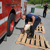 James Neiss/staff photographerNiagara Falls,  NY - Niagara Falls Fire Department Training Captain Sam Fasciano, measures the distance during an obstacle course test to gage fire engine driving proficiency.
