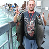 James Neiss/staff photographerNiagara Falls, NY - Fisherman Richard Hahn of Niagara Falls holds up two King Salmon he caught from the New York Power Authority fishing platform. The King Salmon are in the peak of their annual migration into the Niagara River.