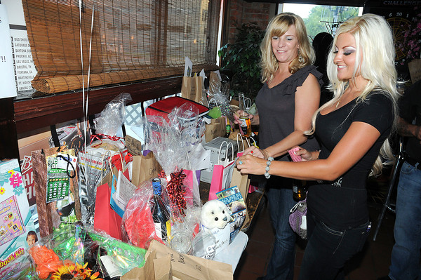 "James Neiss/staff photographerNiagara Falls,  NY - Deanne Gordner of Niagara Falls and Christine Matsulavage of Wheatfield take part in a basket auction at Player's Lounge during a benefit held in memory of Isabella ""Bella"" Tennant. All the proceeds from the event are being donated to Bella's mother Crystal Walker."